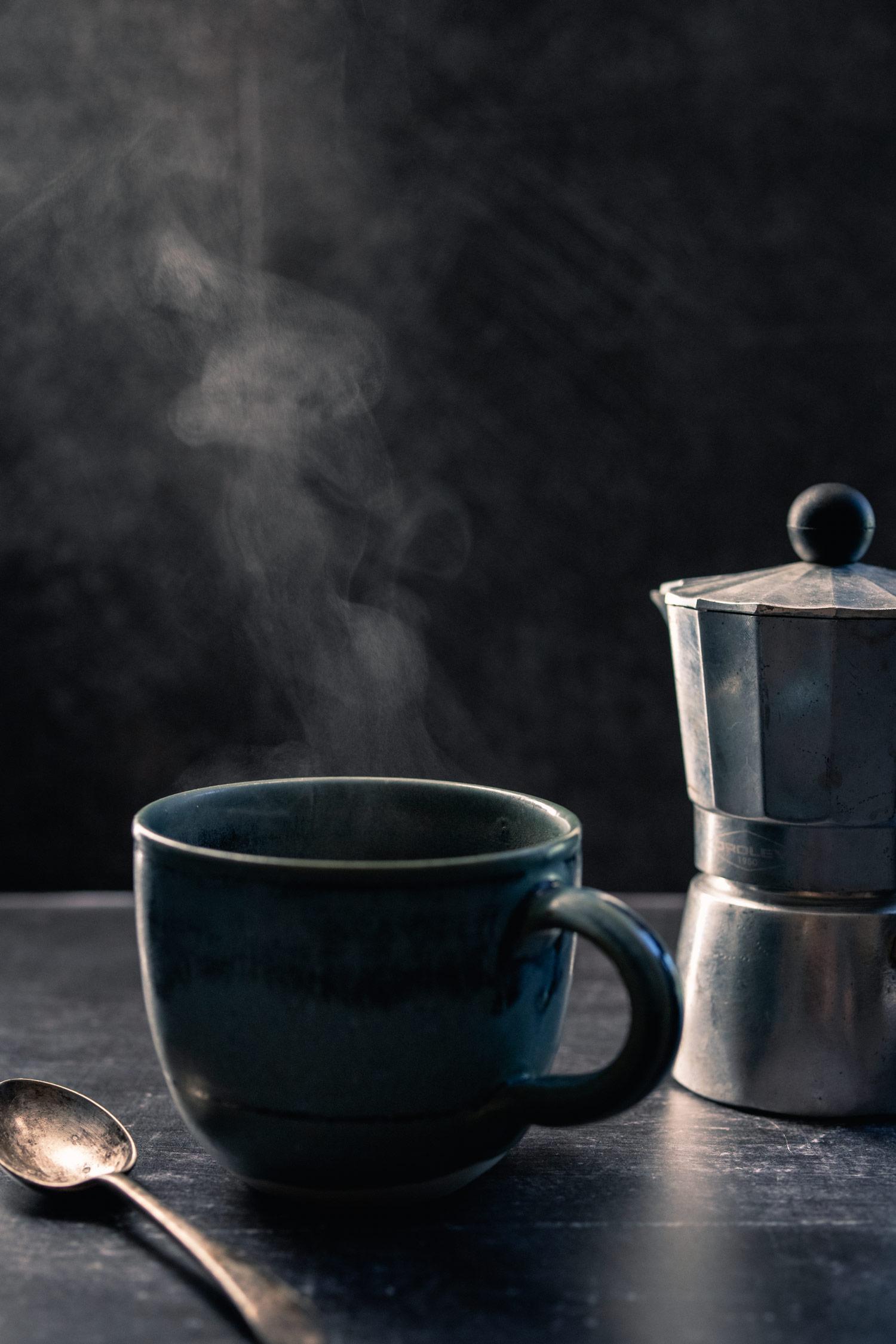 steaming mug of moka pot coffee